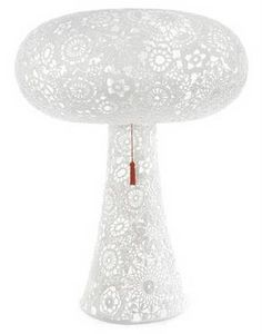 This Marcel Wanders design was featured as a top design by TIME magazine. TIME said it was fabric and resin; the maker's website specifies crochet and epoxy. Either way it's cute and contemporary!