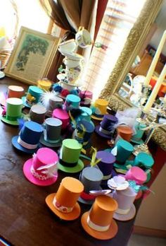 Alice in wonderland themed tea party. Decorative & colorful ideas for DIY top hats. Top hats would be great centerpiece, decorations, photo props or party favors.