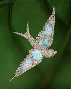 An antique opal and diamond swallow brooch, #gemstonebrooches