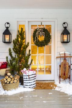 """Welcome guests with a fir at the door. Leave it untrimmed for """"just-chopped-this-down"""" charm."""