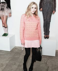 olsendaily:  Ashley wearing sweater by Balenciaga and carrying a Kelly bag by Hermes