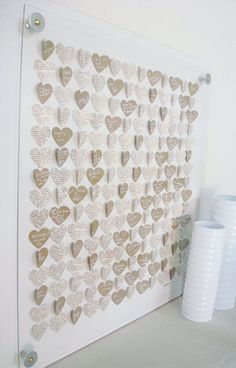 Cute guestbook alternative idea - guests sign small hearts that are turned into artwork  would do the hearts in wedding colours! tres cute
