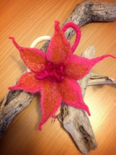 Hand felted brooch using Australian merino wool and embellished with silk tops and silk curls