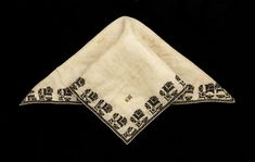 """1600-1625 English Blackwork handkerchief at the Glasgow Museums, Glasgow - From the curators' comments: """"The blackwork border on this linen handkerchief was stitched by an amateur embroiderer, possibly the original owner. The design of repeated stylised, almost geometric, floral motifs sewn, predominately in black silk thread using cross stitch, appears to have been worked by eye rather than counted as no two flowers are the same."""""""