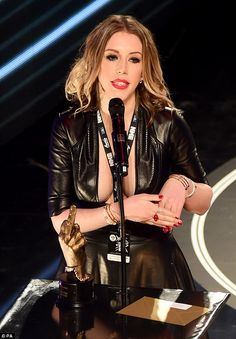 On the podium: The star presented the award for Best British Solo Artist at the ceremony, ...