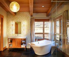 rustic bathroom with exposed wooden beam idea plus mosaic backsplash and black floor tile feat beautiful corner bathtub | Rustic Bathroom Ideas Present Elegant Bathroom  | https://www.designoursign.com #bathroom  #luxurybathroom #luxurybathroomideas #luxuryfurniture #interiordesign #luxurydesign #homedecor #designdetails #rusticbathroom