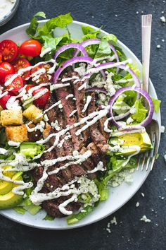 Perfectly seasoned grilled steak, homemade blue cheese dressing AND croutons, plus red onion, avocado, and tomatoes take this black n' blue grilled steak salad to a whole new level of delicious.