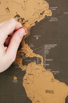 A scratch off world map that lets travelers keep track of which 32x23 deluxe scratch off world map urban outfitters gumiabroncs Image collections
