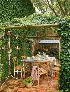 vine covered wall and pergola. Outdoor Rooms, Outdoor Dining, Outdoor Gardens, Outdoor Furniture Sets, Outdoor Decor, Wooden Furniture, Gazebos, Garden Spaces, Pergola Kits