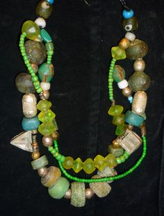Contemporary necklace with old African collected glass and metal beads.