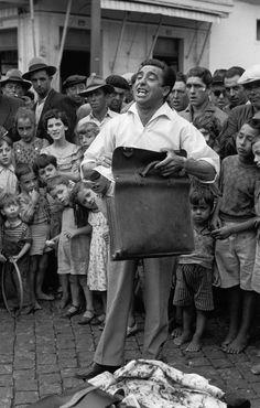 "Henri Cartier-Bresson - Portugal, 1955. Vendedor de "" Banha da Cobra "" -  Snake-Oil salesman ( sunshine salesman ), Lisbon."