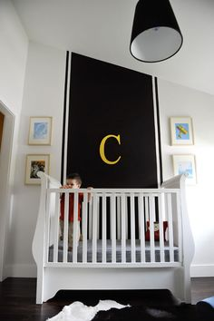 Love this!  Saving this idea in case I need it in a year or so! ;)  Bold black & white boy's nursery. A budget-friendly makeover. #chalkboard #paint #baby #nursery