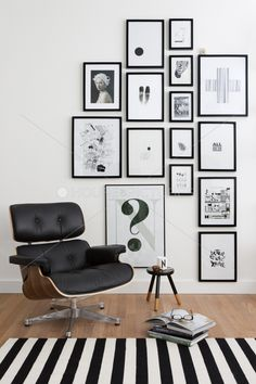 Black and white art printing, iconic midcentury black leather armchair, cousy wooll rug
