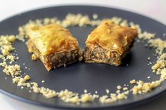 Make an easy Lebanese style Baklava filled with walnuts and pistachios and covered in orange blossom sugar syrup. This will be a hit at any dinner or potluck