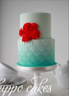 Scalloped turquoise ombre wedding cake with red flowers very tasteful aqua red