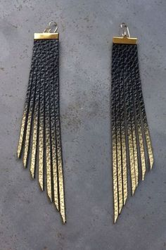 Check out these fabulous leather earrings painted with gold!  Perfect accessory for your Mayko bags wink emoticon  http://www.showponyboutique.com/daly-bird-sunny-black-to-gold.html #accessories #earrings #leather