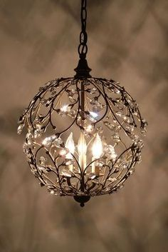 """Lambent Sphere Chandelier I'm not a big fan of the whole """"a chandelier in every room"""" movement (in the bathroom? a chandelier?) - too formal and forced for me. Home Lighting, Chandelier Lighting, Pendant Chandelier, Round Chandelier, Hanging Chandelier, Simple Chandelier, Small Chandeliers, Bathroom Chandelier, Modern Lighting"""