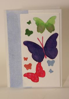 Memorybox stencil `drifting` with watercoloured butterflies, some punched butterflies  and Wendy Vecchi translucent embossing paste over the butterflies
