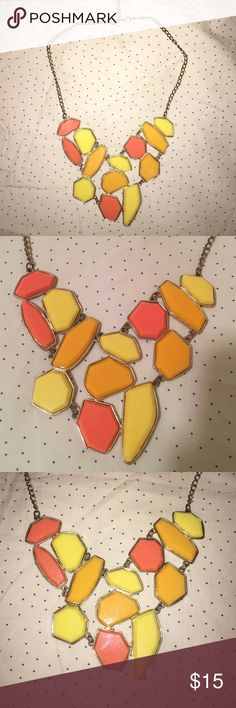 Yellow and Orange statement Necklace Yellow and orange puzzle piece statement necklace. Worn a handful of times. A really fun piece for the summer! Price negotiable :) Jewelry Necklaces