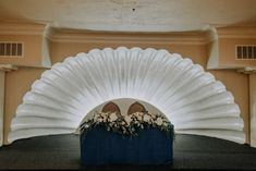 That backlit clamshell is an absolute knockout—a well-deserved center-of-the-universe backdrop for the newlyweds' sweetheart table. | The Lafayette Hotel, Swim Club and Bungalows San Diego, CA