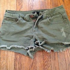 Army green cut off shorts! These are so cute and perfect for summer!!! They were made to look like cut offs and distressed! The look great with converse or a cute pair of sandals! They are an army green color! They come from a smoke free environment! I don't hold or trade! Please don't negotiate the price in the comments, use the offer button! Forever 21 Shorts Jean Shorts