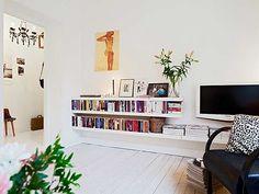 like these low slung book shelves for livingroom