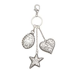 """Tendril Charms-Silver Clip-on Add a little whimsy to your favorite bag or key ring with the classic Tendril Heart, Star, and Teardrop. Each charm features rhinestones and the classic Tendril scroll. Tendril Collection • Silver tone • 6.5"""" L • Lobster clasp • Clip-on or keychain"""