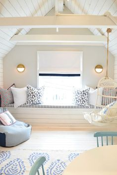 Get inspired to make use of attic space with this stunning kids' playroom. Thanks to the classic navy and white color scheme and hints of bohemian decor, this kid-friendly room still fits in with the traditional and fresh style of your home.