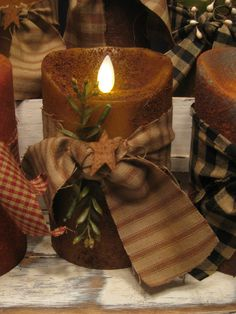 """Our Country Primitive Flameless Candles we make here at our shop in KY. Please see our website www.theredbrickco... to order or simply call the shop 270-351-1224. These are available in 8 colors. Either Prim or Grungy. This one is Grungy Mustard 5""""."""