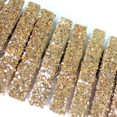 For hanging photos. Gold Glittered Clothespins a dozen beauties on a decorative tag on Etsy, $5.00