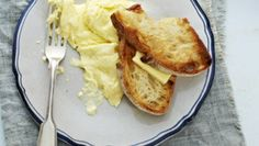 Bill Grangers Scrambled Eggs.  Seriously delicious - never mind the cream, it's a mere 1/3 cup ...