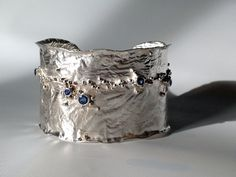 reticulation silver | Reticulated silver cuff bracelet with 5 blue sapphires.