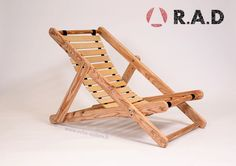 This upcycled chair is made from repurposedpallets slats for the structure, bed slats for the seat and curtain rods. It was made in the city of Dunkerque