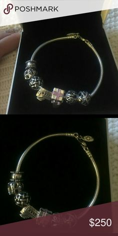 Pandora Bracelet & Charms Bracelet is brand new. Charms are slightly used. Size 7.9. Comes with 5 Pandora charms and 1 Pandora clip. I also have the charms in individual listing Pandora Jewelry Bracelets