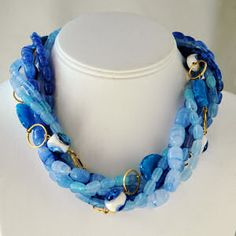 Murano Glass Necklace at Tensanremo.com. The gold rings against the many tones of blue gives this gorgeous necklace and Amalfi Coast feel