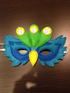 Peacock felt mask.  Available for purchase $25.  Please email me at vanbee79@gmail.com.