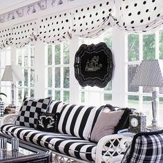 Several patterns in black and white combine to create an eye-catching porch. Wide stripes, checks, plaids, dots, and toile mix easily due to various sizes and a common color theme. Black And White Love, Black And White Interior, Black And White Fabric, Black And White Valance, Polka Dot Curtains, White Curtains, White Cottage, Black Decor, White Decor