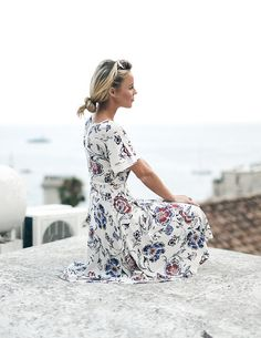 Mary Seng of Happily Grey looks out to Positano, Italy in Ann Taylor's Floral Lace Midi Dress.
