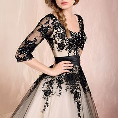I'd love to own this black lace dress