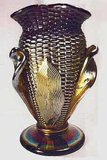 Northwood carnival glass Corn Vases.  While regular corn vases are desirable, they are readily available.  The version that has the pulled husk, however, is extremely rare!  One sold for $17,000 in 1990. http://www.morninggloryantiquescollect.com/