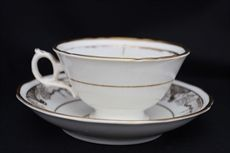 Regency footed teacup and saucer with gilded detailing, including hatching and seaweed techniques c 1830