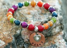 Personalized Rainbow Bridge Bracelet.  We give our hearts to our pets in return they give us theirs. The loss of a pet is one of the most difficult times in our lives, the bracelet is a lovely colorful piece that can be worn in honor of your pet. Our price: $40.00