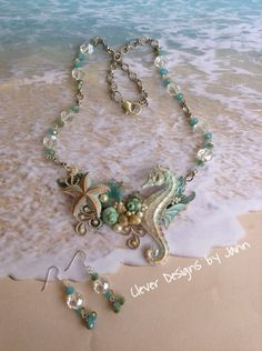 Adventures In The Sea Necklace Set .. All metal components are from B'sue Boutiques and are painted white and then perfect pearls was used on top of paint .. Components used are Seahorse, Starfish, Anchor, Leafs, Shells, Pearls & a necklace blank .. Silver chain and glass beads complete this beauty .. Matching Earrings .. Designed by Jann Tague .. Clever Designs .. https://www.facebook.com/JewelsByJann