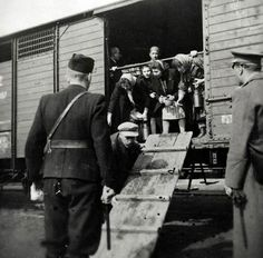 Nazi soldiers, unloading the Jews to be then exterminated by gas'