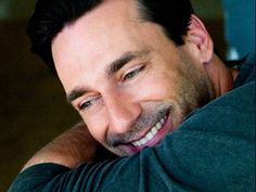 Really like this close-up, smiling and looking away.  Jon Hamm