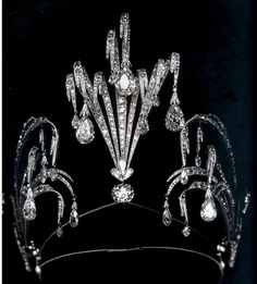 The Waterfall Tiara created by Chaumet in 1899. Elements fashioned to imitate sprays of water, set with diamonds, support pear-shaped diamonds with tremble with every movement. Most likely a silver wedding anniversary gift from the Grand Duke Vladimir to the grand duchess.
