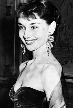 Audrey Hepburn sporting extravagant three-tiered earrings at a premiere in 1953.