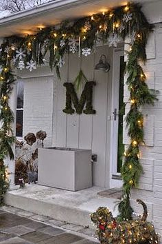 The hanging snowflakes in garland along the roof of front porch