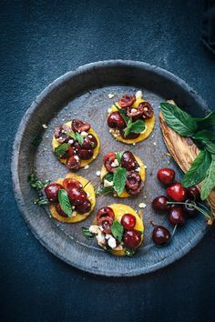 This Cherry Mint Polenta Bruschetta is the perfect appetizer or starter to feed a crowd. The tart cherries and salty feta works perfectly on top of the savory polenta rounds.