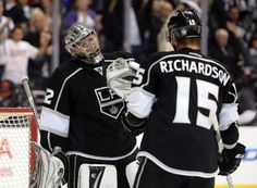 Jonathan Quick #32 of the Los Angeles Kings celebrates a 3-0 shutout win over the San Jose Sharks with Brad Richardson #15 to take a 3-2 series lead (Photo by Harry How/Getty Images)